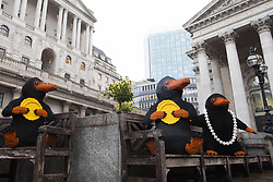EDITORIAL USE ONLY Three LEGO brick Nifflers, which are fan-favourite creatures from the new J.K. Rowling film Fantastic Beasts: The Crimes of Grindelwald, appear outside the Bank of England in London to celebrate LEGO Group's new range of Wizarding World play sets.