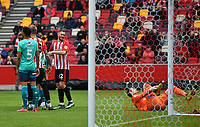Football - 2020 / 2021 Sky Bet Championship - Semi-final play-offs - Second leg - Brentford vs AFC Bournemouth - Brentford Community Stadium<br /> <br /> Henrik Dalsgaard of Brentford laughs as Asmir Begovic of Bournemouth goes down injured.<br /> <br /> COLORSPORT/ASHLEY WESTERN