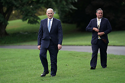 """ISP POOLWASHINGTON, DC - JULY 23: White House Chief of Staff John Kelly (L) walks on the South Lawn during the 2018 Made in America Product Showcase July 23, 2018 at the White House in Washington, DC. The White House held the showcase to """"celebrates every state's effort and commitment to American-made products, and will allow these companies to speak with senior Administration officials, including the President, the Vice President, members of the Cabinet, and senior staff."""" (Photo by Alex Wong/Getty Images)"""