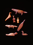 Carved ivory seal, foxes, birds including a loon, rabbit and human Eskimo artifacts from St. Lawrence Islnad in the collections of Ellen Paneok and Fred Hirschmann, Alaska.