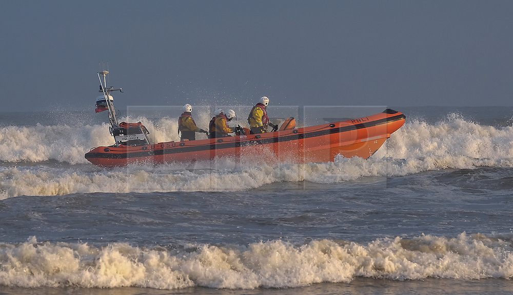 © Licensed to London News Pictures. <br /> 28/12/2014. <br /> <br /> Saltburn, United Kingdom.<br /> <br /> Crews from the Redcar RNLI conduct training in the sea off Saltburn beach on a freezing cold morning on Teesside.<br /> <br /> Photo credit : Ian Forsyth/LNP