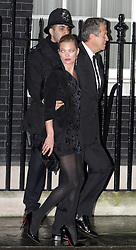 ©London News pictures. 21.02.2011. Kate Moss and Mario Testino leave after an event at No 10 Downing Street hosted by Prime Minister's wife Samantha Cameron to celebrate the UK's fashion industry. Picture Credit should read Carmen Valino/LNP