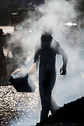 Road construction worker in tar smoke, Taunggyi, Myanmar