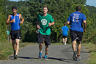 Monroe, New York - Competitors in the Southern Orange County YMCA Triathlon and Duathlon on Aug. 34, 2013.