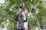 Protestors camp in trees above the Nelson Mandela sculpture during an Extinction Rebellion climate change protest at Parliament Square in London, Thursday, Sept. 3, 2020.(VXP Photo/ Vudi Xhymshiti)