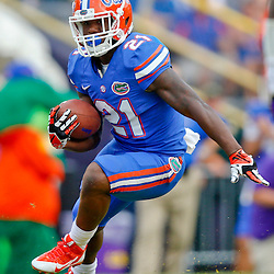 Oct 12, 2013; Baton Rouge, LA, USA; Florida Gators running back Kelvin Taylor (21) against the LSU Tigers during the second half of a game at Tiger Stadium. LSU defeated Florida 17-6. Mandatory Credit: Derick E. Hingle-USA TODAY Sports