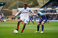 Jamal Lowe of Portsmouth under pressure from Michael Harriman of Wycombe Wanderers during the EFL Sky Bet League 1 match between Wycombe Wanderers and Portsmouth at Adams Park, High Wycombe, England on 6 April 2019.