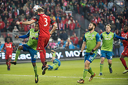 December 9, 2017 - Toronto, Ontario, Canada - Toronto FC defender DREW MOOR (3) heads the ball over Seattle Sounders defender KELVIN LEERDAM (18) while \s17 looks on during the MLS Cup championship match at BMO Field in Toronto, Canada.  Toronto FC defeats Seattle Sounders 2 to 0. (Credit Image: © Mark Smith via ZUMA Wire)