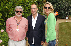 """Left to right, GEORGE LUCAS, PAUL MCKENNA and CLARE STAPLES at the Goodwood Festival of Speed on 9th July 2006.  Cartier sponsored the """"Style Et Luxe' for vintage cars on the final day of this annual event at Goodwood House, West Sussex and hosted a lunch.<br /><br />NON EXCLUSIVE - WORLD RIGHTS"""