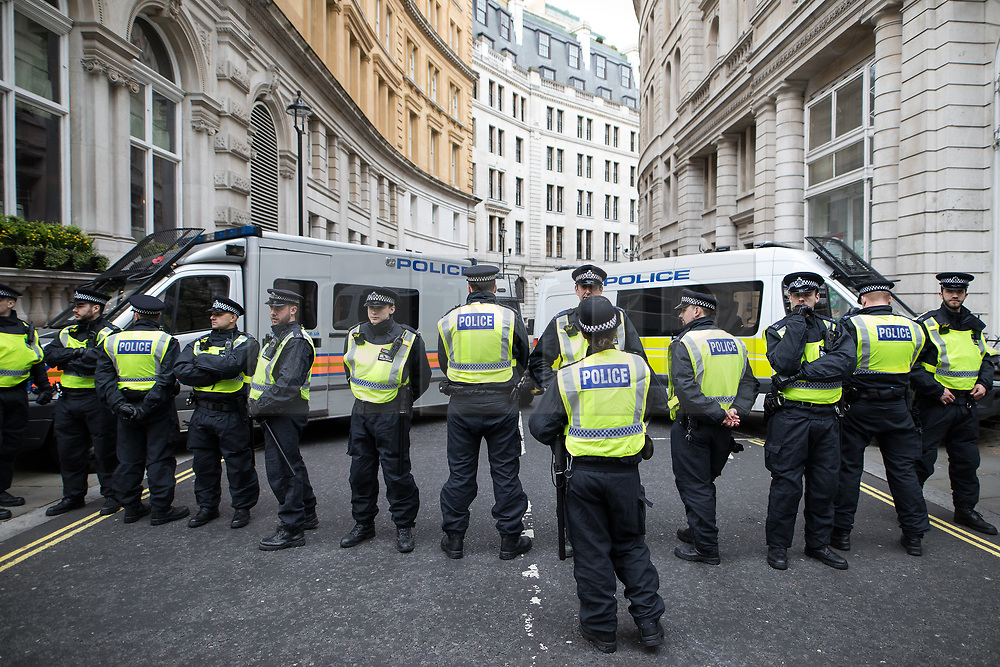 © Licensed to London News Pictures . 01/04/2017 . London , UK . Police seal off roads around Whitehall and Northumberland Avenue . The EDL and Britain First both hold demonstrations in London , opposed by anti-fascist groups , including Unite Against Fascism . Photo credit : Joel Goodman/LNP