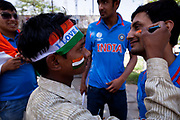 India fans have face paint applied just before the ICC 2011 Cricket World Cup semi final match between their team and Pakistan, Mohali, India