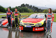 Ander Vilarino (Center) car racing driver has presented his car for the European official NASCAR Championship 2014 next to his father Andres Vilarino (L) and his sister Angela (R) in the circuit of Olaberria on March 26, 2014, Basque Country. On March 27, Ander Vilarino will begin with trainings in Nogaro Circuit, France. (Ander Gillenea / Bostok Photo)