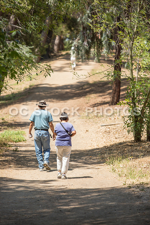Couple Walking on Trail at Ralph B. Clark Regional Park in Buena Park