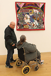 Visually impaired art class from Mysight charity with volunteer visiting Nottingham Contemporary art gallery to see Haitian exhibition.