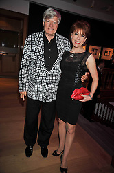 KATHY LETTE and her husband Geoffrey Robertson at fundraising dinner and auction in aid of Liver Good Life a charity for people with Hepatitis held at Christies, King Street, London on 16th September 2009.