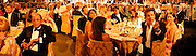 Liz Hurley, Jemima Khan, Hugh Grant offering his £200,000 bid on condition that he and a rival bidder ( £190,000 both share the dinner with Elton, , Tamara Mellon.  Sir Elton John's White Tie and Tiara Ball. Windsor, 28 June 2003. © Copyright Photograph by Dafydd Jones 66 Stockwell Park Rd. London SW9 0DA Tel 020 7733 0108 www.dafjones.com