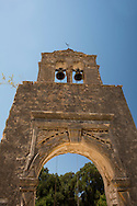 The carved, stone bell tower of Agios Georgos in Veliantatika, Paxos, The Ionian Islands, The Greek Islands, Greece, Europe