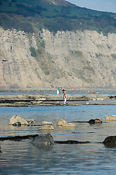 tourist on the shore line Robin Hoods Bay north Yorkshire.September 2010 .Images © Paul David Drabble