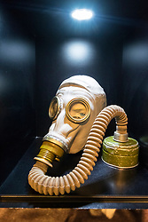 Military gas mask on display at DDR Museum, showing life in former East Germany,  in Mitte Berlin, Germany
