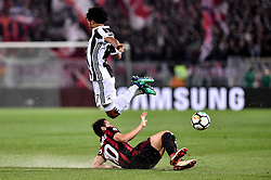 May 9, 2018 - Rome, Italy - Juan Cuadrado of Juventus is challenged by Hakan Calhanoglu of Milan during the TIM Cup - Coppa Italia final match between Juventus and AC Milan at Stadio Olimpico, Rome, Italy on 9 May 2018. (Credit Image: © Giuseppe Maffia/NurPhoto via ZUMA Press)