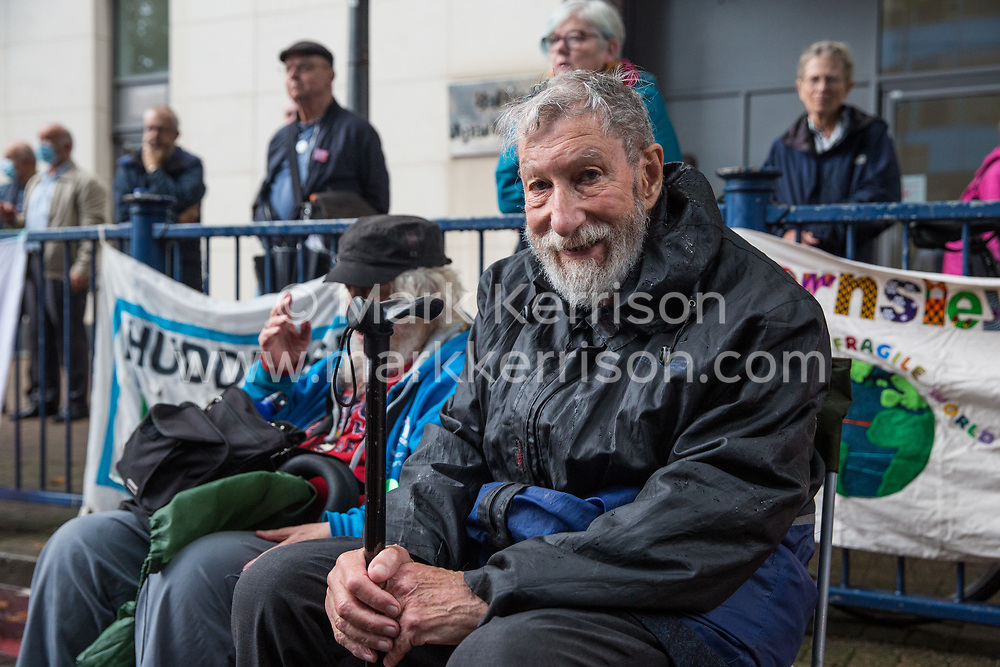 London, UK. 14th September, 2021. John Lynes, 93, of Veterans for Peace UK protests with Stop The Arms Fair activists outside ExCeL London on the first day of the DSEI 2021 arms fair. Activists from a range of different groups have been protesting outside the venue for one of the world's largest arms fairs for over a week.