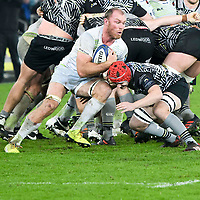 Rugby Union - 2017 / 2018 European Rugby Champions Cup - Pool Two: Ospreys vs. Saracens<br /> <br /> Calum Clark of Saracens tackled by Will Jones of Ospreys, at The Liberty Stadium.<br /> <br /> COLORSPORT/WINSTON BYNORTH