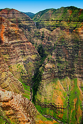 Wai`alae or Waialae Falls at distance, Waimea Canyon, the 'Grand Canyon of the Pacific Ocean', approximately one mile wide and ten miles long, more than 3,500 feet deep, State Park, Kauai, Hawaii