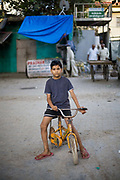 A boy on his bicycle near the Chiragh-i-Delhi Dargah.