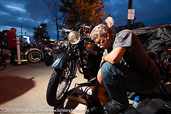 Mark Zenor working on his 1946 Norton Model 18 during the Cross Country Chase motorcycle endurance run from Sault Sainte Marie, MI to Key West, FL (for vintage bikes from 1930-1948). Stage 2 from Ludington, MI to Milwaukee, WI, USA. Saturday, September 7, 2019. Photography ©2019 Michael Lichter.