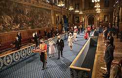 Queen Elizabeth II, accompanied by the Prince of Wales, proceeds through the Royal Gallery before delivering the Queen's Speech during the State Opening of Parliament in the House of Lords at the Palace of Westminster in London. Picture date: Tuesday May 11, 2021.