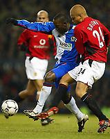 Fotball 7. januar 2003. Manchester United v Blackburn Rovers (Worthington Cup Semi Final 1st Leg) <br />United's Wes Brown battles with rovers Dwight Yorke<br />Photo. Aidan Ellis, Digitalsport