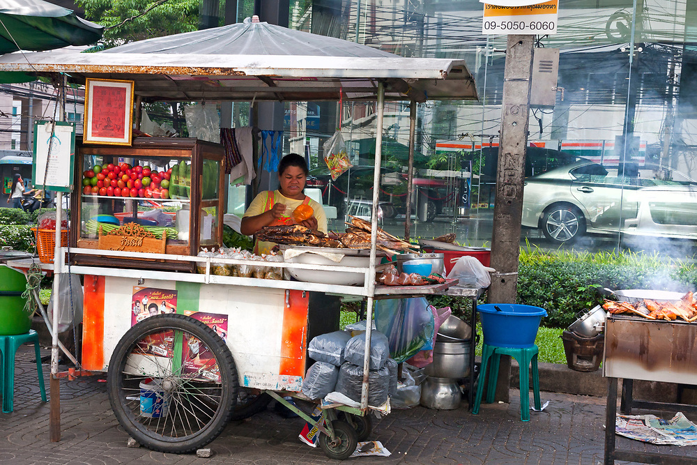 Street vendors cooking and preparing food, Bangkok, Thailand