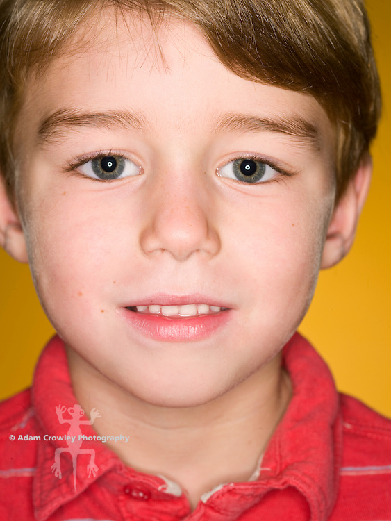 Boy, 7 years old, stares into camera, close up.