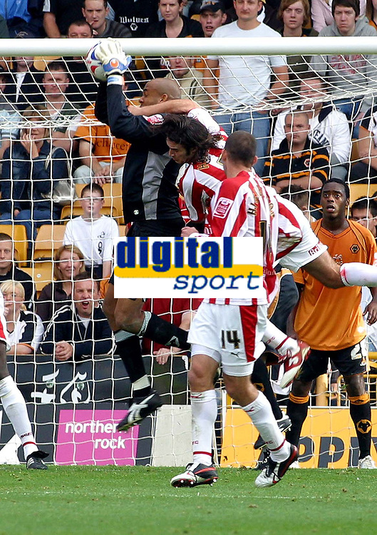 Photo: Dave Linney.<br />Wolverhampton Wanderers v Stoke City. Coca Cola Championship. 23/09/2006Wolves keper.Matt Murray collects the ball safely despite the attention of the Stoke attack