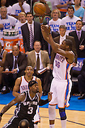 June 2, 2012; Oklahoma City, OK, USA; Oklahoma City Thunder forward Kevin Durant (35) takes a shot over San Antonio Spurs forward Stephen Jackson (3) during a playoff game  at Chesapeake Energy Arena.  Thunder defeated the Spurs 109-103 Mandatory Credit: Beth Hall-US PRESSWIRE