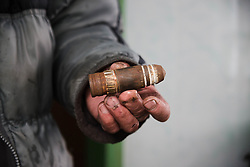 A resident of Debaltsevo holds a large calibre round that hit his home during the fighting in the city in February. Many residents fled and many homes were destroyed in shelling between Ukranian forces and forces loyal to the local government authorities in Donetsk and Lugansk.