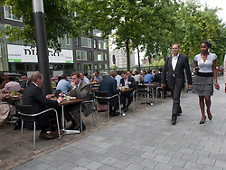 Office workers at lunch in restaurants in modern business district at Amsterdam Zuid in The Netherlands