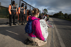 Harefield, UK. 12th September, 2020. Activists acting in solidarity with HS2 Rebellion sit behind banners to block a gate providing access to a site for the HS2 high-speed rail link. Anti-HS2 activists continue to try to prevent or delay works on the controversial £106bn HS2 high-speed rail link in the Colne Valley where thousands of trees have already been felled.