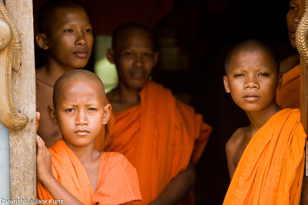 02 JULY 2006 - UDONG, CAMBODIA: Young Buddhist monks in the doorway of their dormitory during a ceremony to mark young men and boys becoming monks at a small monastery near Udong, Cambodia. Photo by Jack Kurtz / ZUMA Press
