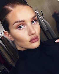 """Rosie Huntington-Whiteley releases a photo on Instagram with the following caption: """"sleek glam"""". Photo Credit: Instagram *** No USA Distribution *** For Editorial Use Only *** Not to be Published in Books or Photo Books ***  Please note: Fees charged by the agency are for the agency's services only, and do not, nor are they intended to, convey to the user any ownership of Copyright or License in the material. The agency does not claim any ownership including but not limited to Copyright or License in the attached material. By publishing this material you expressly agree to indemnify and to hold the agency and its directors, shareholders and employees harmless from any loss, claims, damages, demands, expenses (including legal fees), or any causes of action or allegation against the agency arising out of or connected in any way with publication of the material."""