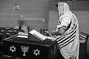 Jewish man at prayer in a synagogue