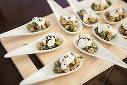 Mushrooms with cottage cheese as appetizers on porcelain spoons