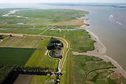 Nederland, Zeeland, Zeeuws-Vlaanderen, 12-06-2009; Hertogin Hedwigepolder met Verdronken Land van Saeftinghe in de achtergrond, het Nauw van Bath midden aan de horizon. In verband met de komende verdieping van de vaargeul van de nabijgelegen Westerschelde, moet er volgens de Europese habitatrichtlijn natuurcompensatie komen. Door deze polder en de nabijgelegen Belgische Prosperpolder, a te ontpolderen, wordt er grond terug gegeven aan de natuur, zogenaamde natuurcompensatie (advies commissie onder leiding van Ed Nijpels). De maatregelen zijn omstreden, in het Belgisch deel van het gebied is men echter reeds begonnen..Hertogin Hedwigepolder with Drowned Land of Saeftinghe in the background. Because of the future enlargement of the fairway of the nearby Westerschelde, the nature has to be compensated (according to the European Habitats Directive). The Hertogin Hedwige polder (and the adjacent Belgian polder - on the other side of the border - the Prosperpolder) are to be given back to nature, i.e. are to be 'de-polderd'. The measures are controversial, but in the Belgian part of the polders works have already been started.Swart collectie, luchtfoto (25 procent toeslag); Swart Collection, aerial photo (additional fee required).foto Siebe Swart / photo Siebe Swart
