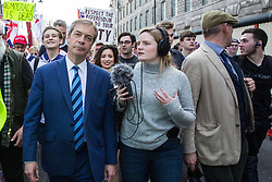 London, UK. 29th March, 2019. Nigel Farage joins pro-Brexit activists from Leave Means Leave on the final leg of the March to Leave on the day on which the UK was originally to have left the European Union.