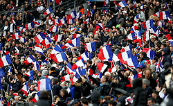 France fans wave flags in the stands during the Guinness Six Nations match at the Stade de France, Paris.
