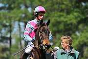 27 March 2010 : Darren Nagle aboard Eye Said Scat Cat leaves the paddock for the first race.