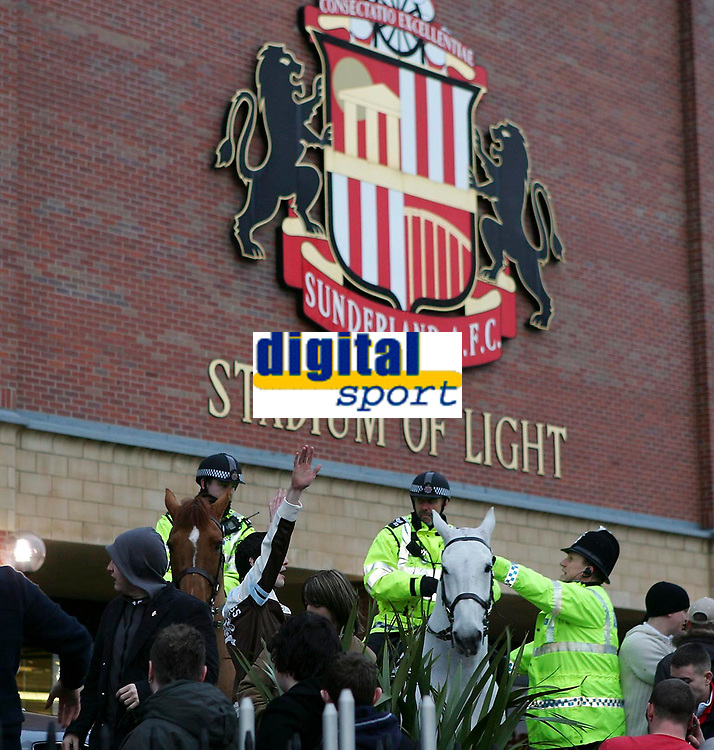 Photo: Andrew Unwin.<br />Sunderland v Wigan Athletic. The Barclays Premiership. 11/03/2006.<br />The police intervene as Sunderland fans protest after the game.