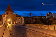Narrow cobblestone streets at dawn with castle in historic Cesky Krumlov, Czech Republic