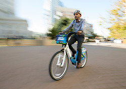 Carlos Hernandez, bike share coordinator for the city of Oakland, Calif., shows off one of the roughly 800 bicycles that will be part of a new program with neighboring Emeryville and Berkeley, Thursday, Nov. 3, 2016, at Frank Ogawa Plaza in Oakland. (Photo by D. Ross Cameron)