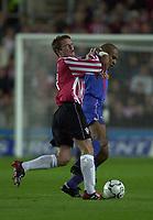 Photo: Richard Lane.<br />Southampton v Steaua Bucharest. UEFA Cup. 24/09/2003.<br />Falemi holds off Matt Oakley.